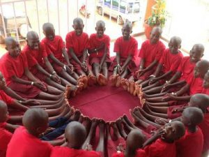 Uganda Orphans gather in a circle