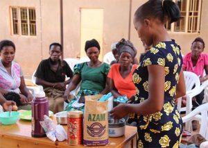 Pastor Pauline teaching women how to bake in Uganda