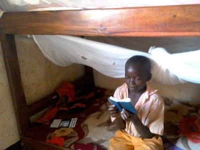 Mubogi reading his Bible
