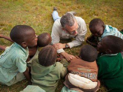 Craig Muller playing with kids in Kenya