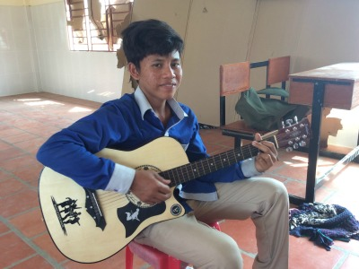 Cambodian boy playing a guitar