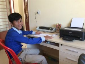 Student in Cambodia helping at an International School