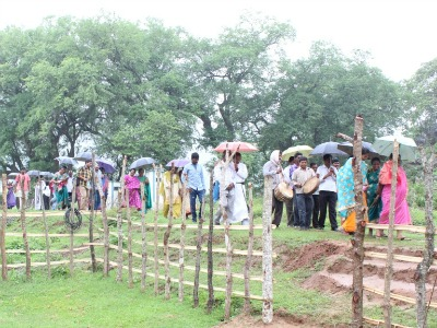 Indian people walking to the opening of a new church