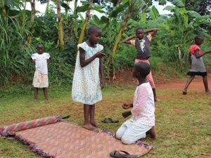 Children in Uganda acting out a play