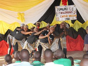 Yimuka Children's Choir preforming during church at Baka Kinship