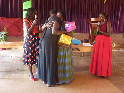 Women at the Women of Worth Workshop exchanging gifts.