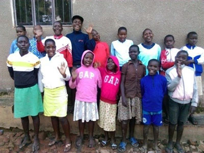 You were an answer to the Buloba Kinship Kids' prayers for warm sweaters!