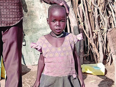Mary is seven years old, but she looks four, and she has known enough heartache for a lifetime.