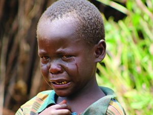 Young boy with tears streaming down his face