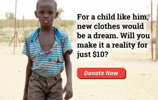 An orphan wearing a ripped shirt and dirty pants who needs help to get the gift of new clothes.