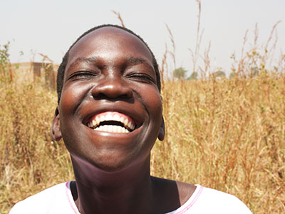 Young man smiling up at the sky