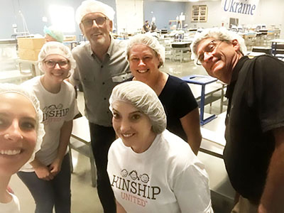 Kinship team members at a FMSC packing event
