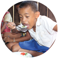 Hungry child eating rice