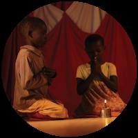 Children using a kerosene lamp