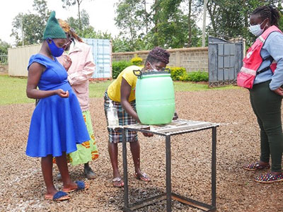 Patients washing their hands before seeing the doctor