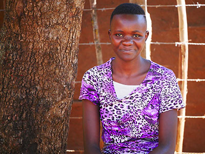 A young girl from Kenya with a slight smile