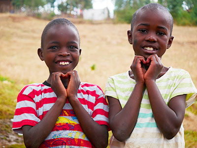 Children making hearts with their hands