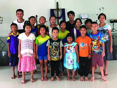 A group of children from Thailand standing together